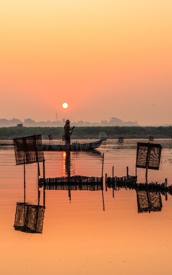 Sunrise and sunset at U bein bridge Amarapura, Mandalay, Myanmar. stock image