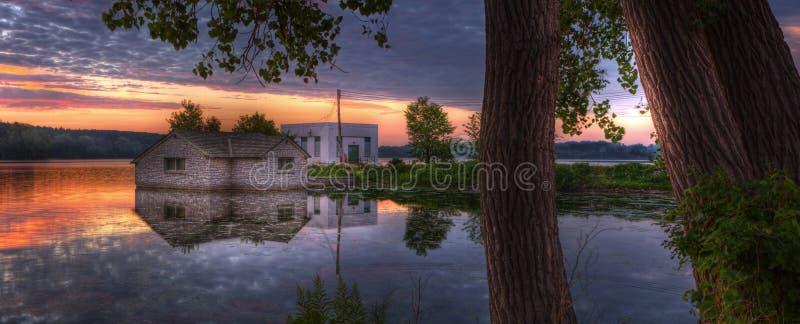 Sunrise panorama of a pump house utility building stock photos