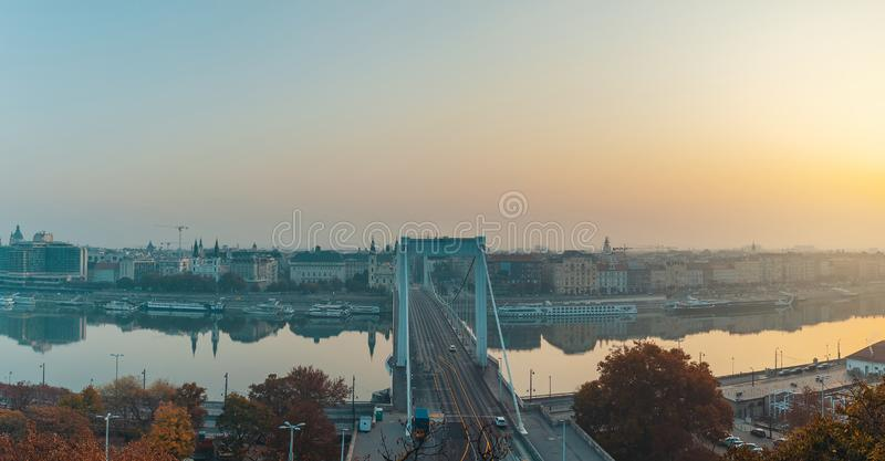 Sunrise panoramic view of Budapest city and Danube river with Elizabeth bridge. In the center, autumn season image stock images