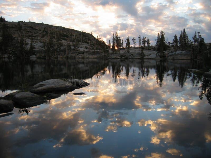Sunrise on Paradise lake royalty free stock image