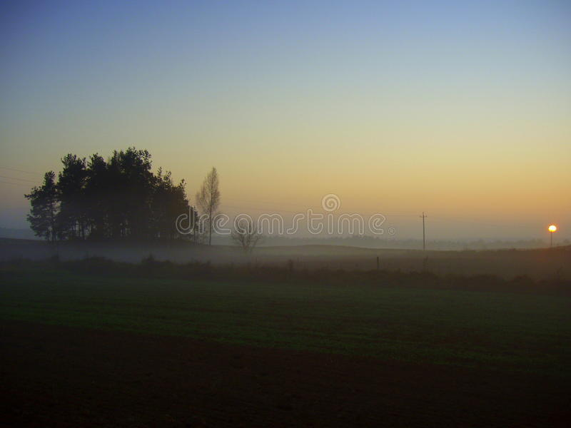 Sunrise. This picture was taken early in the morning in the polish area Podlachia near Suwalki. It was a very fresh and foggy Saturday morning.The picture shows royalty free stock photo