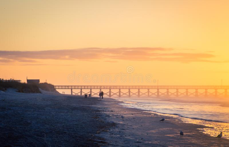 Sunrise in myrtle beach. Sunrise on a pier in myrtle beach united states royalty free stock images