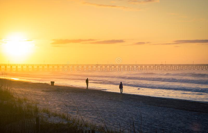 Sunrise in myrtle beach. Sunrise on a pier in myrtle beach united states royalty free stock photo