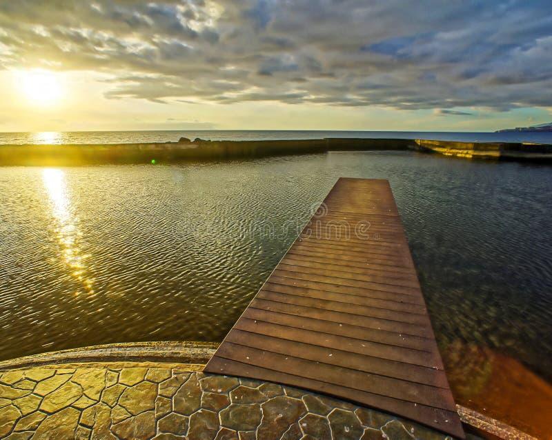 Sunrise Pier. Sunrise on a Pier over Atlantic Ocean in Tenerife Canary Islands Spain stock photography
