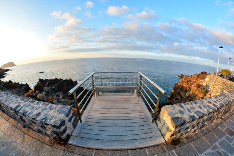 Sunrise Pier. Sunrise on a Pier over Atlantic Ocean in Tenerife Canary Islands Spain stock photo