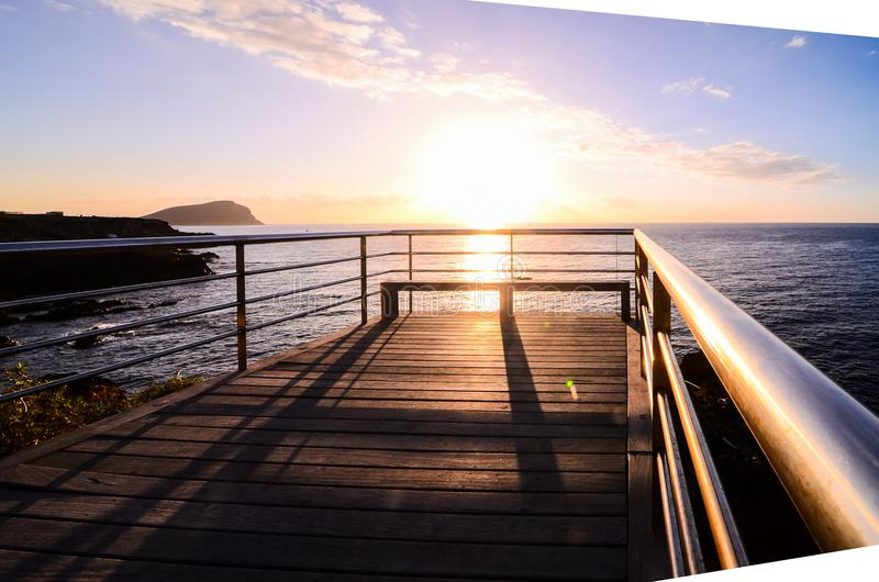 Sunrise Pier. Sunrise on a Pier over Atlantic Ocean in Tenerife Canary Islands Spain stock image