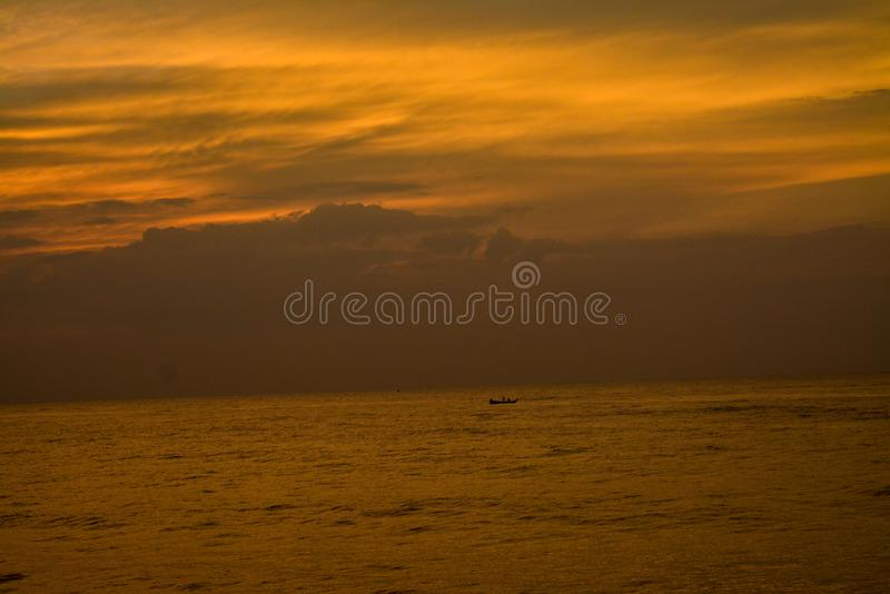 A sunrise in Puducherry, India. The image was captured from the Promenade Beach in Puducherry, India at early morning. It shows the colours of the sky right royalty free stock photography
