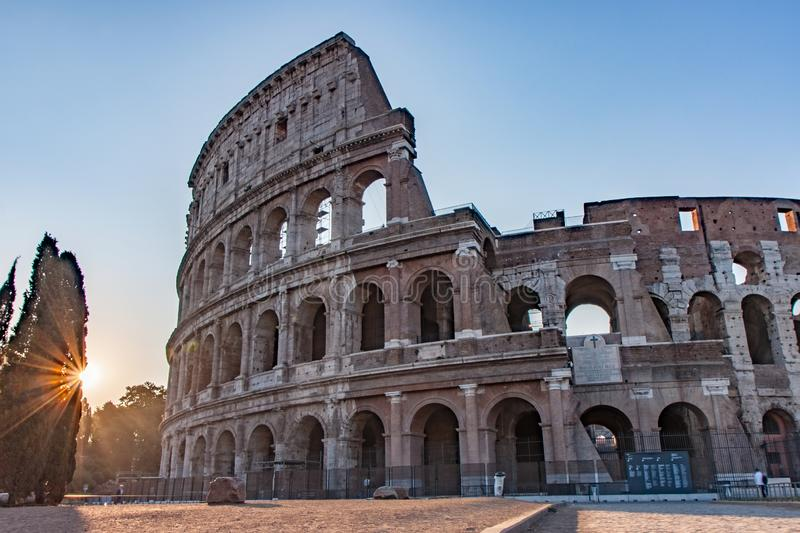 Sunrise Rays by the Colosseum in Rome Italy. Sunrise Rays by the Famous Colosseum in Rome Italy royalty free stock photo
