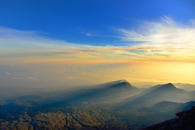 Download Sunrise Rays Of Light On Mountains And Dramatic Sky Stock Photo - Image: 33991112