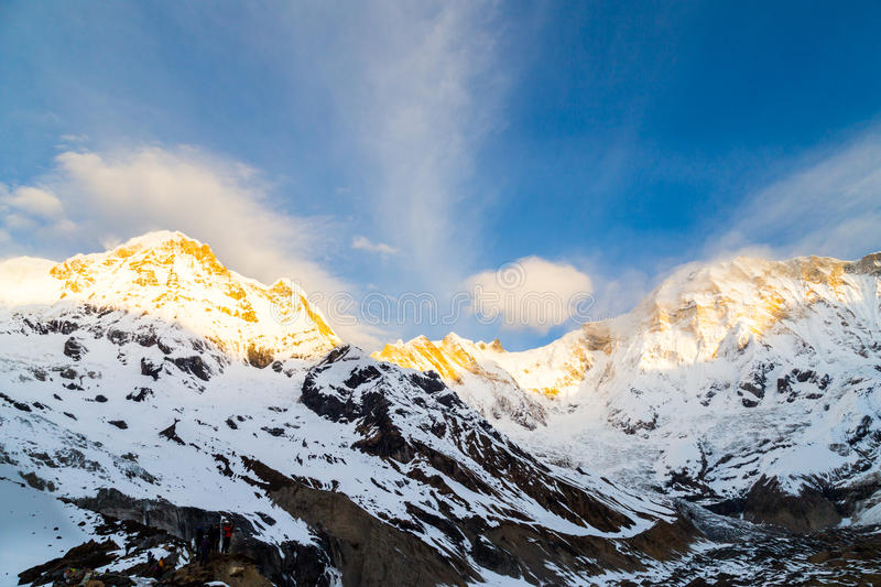 Sunrise rays on the peak of Annapurna South from Annapurna Base Camp, Nepal stock photo