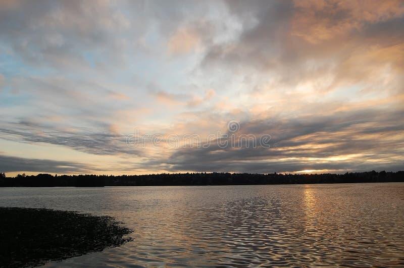 Sunrise reflected in GreenLake. Sunrise reflected in the waters of Greenlake, Seattle, Washington royalty free stock image