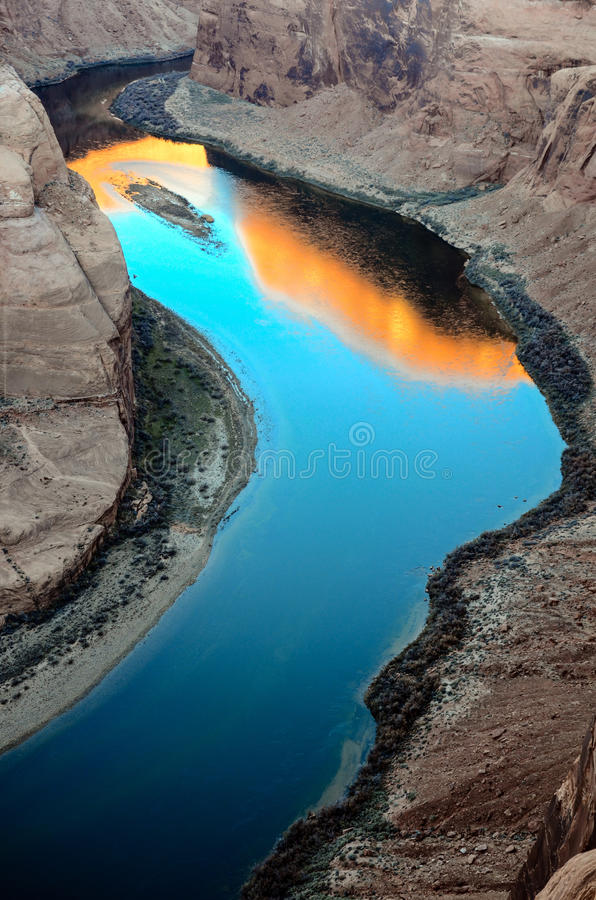 Sunrise reflection on Colorado River surface at Horseshoe Bend in Arizona. USA royalty free stock photography