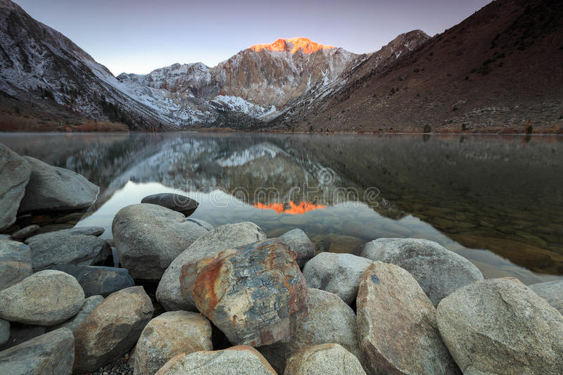 Sunrise reflection at Convict Lake. Sunrise at convict lake in the eastern sierra mountains, Califonia, USA stock photos