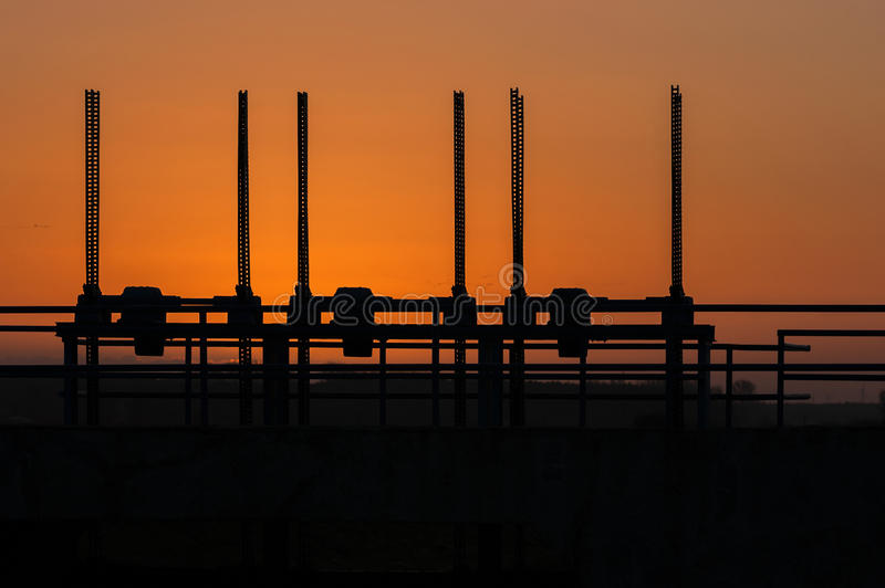 SUNRISE RIVER DAM. Spring sunrise on a small river dam royalty free stock image