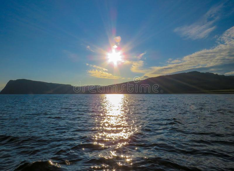 Sunrise on the river. Mountain Coast royalty free stock images