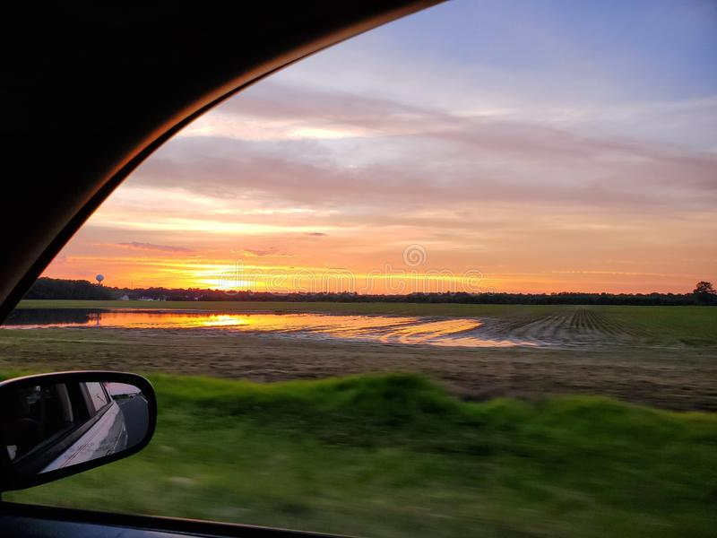 Sunrise on the road royalty free stock photos