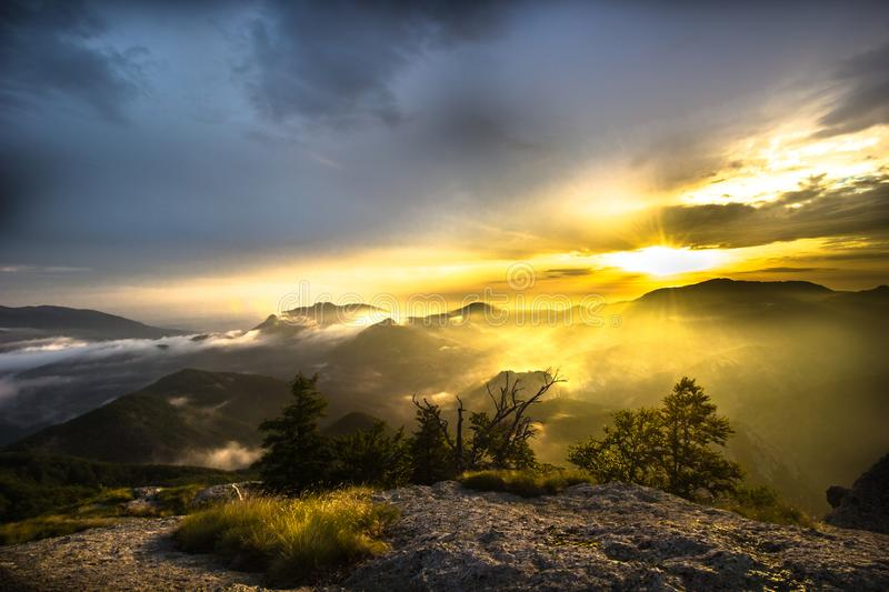 The sunrise from the rock royalty free stock images