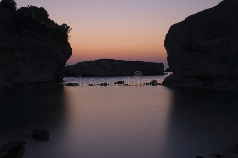 Download Sunrise at rocky sea stock image. Image of deserted, cool - 24595