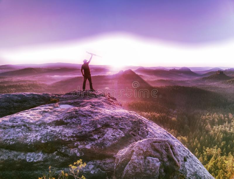 Sunrise on a rocky summit. Artist works in nature royalty free stock images