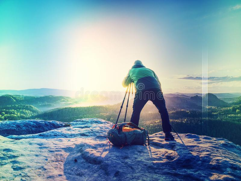 Sunrise on a rocky summit. Artist works in nature stock photography