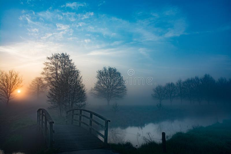 Mist at a small river stock photos