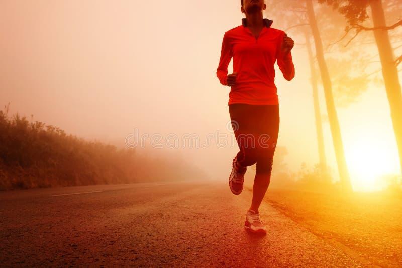 Sunrise running woman stock photography