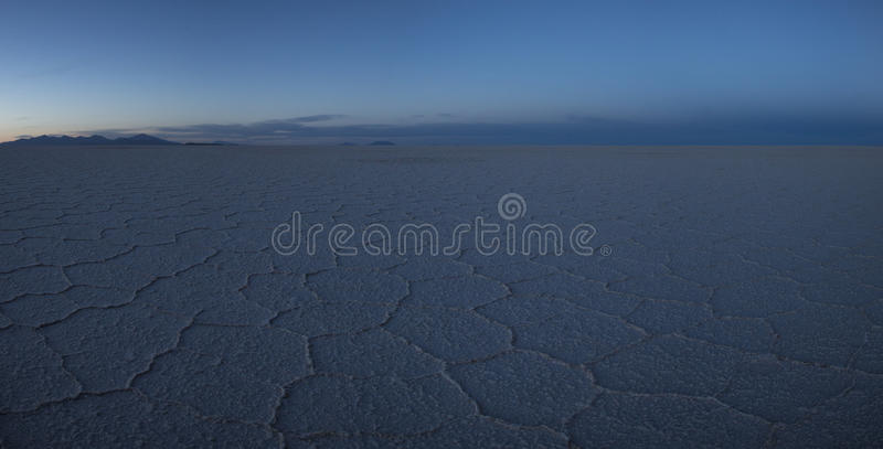 Sunrise on the Salar of Uyuni in the morning, Bolivia. View of the Salar of Uyuni early in the morning during the dry season, the salt plains are a completely royalty free stock photos