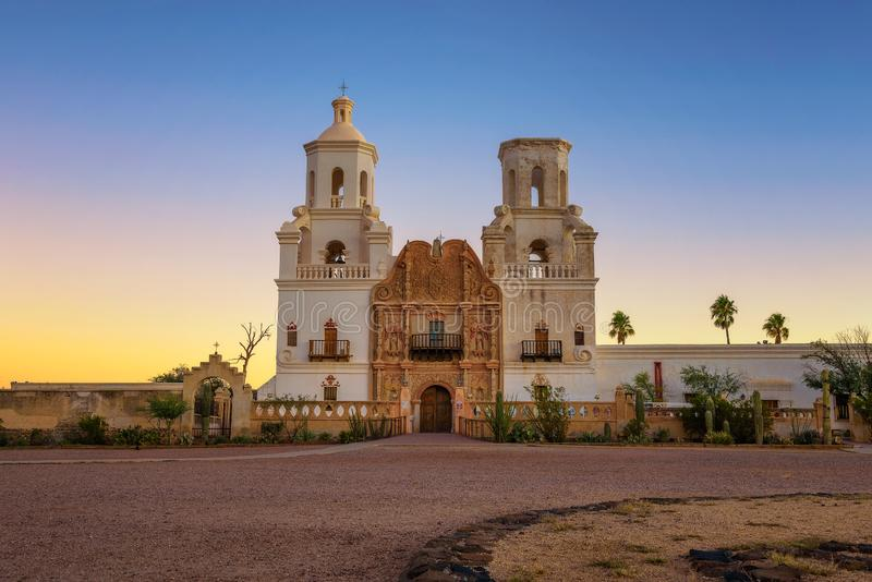 Sunrise at the San Xavier Mission Church in Tucson. Arizona. This historic spanish catholic mission was founded in 1692 and is located on the Tohono O`odham stock image