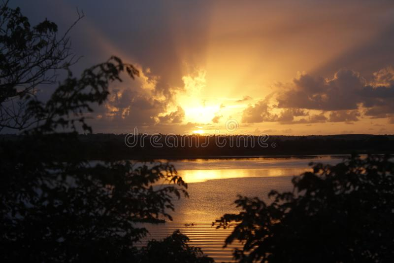 Sunrise in the Sao Francisco River with trees royalty free stock photo