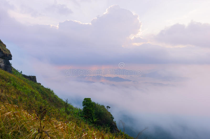 Sunrise scene with the peak of mountain and cloudscape royalty free stock photo
