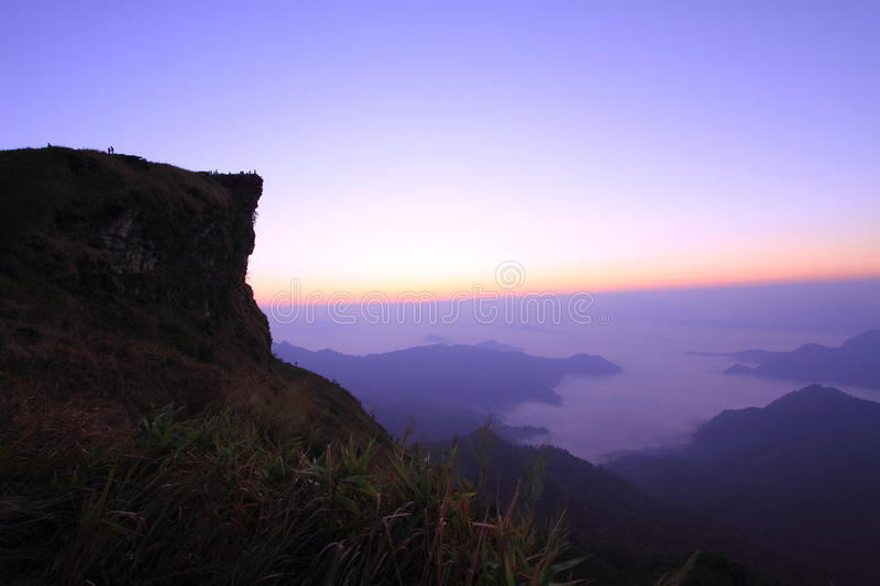 Sunrise scene with the peak of mountain and cloudscape at Phu chi fa in Chiangrai. Thailand stock images