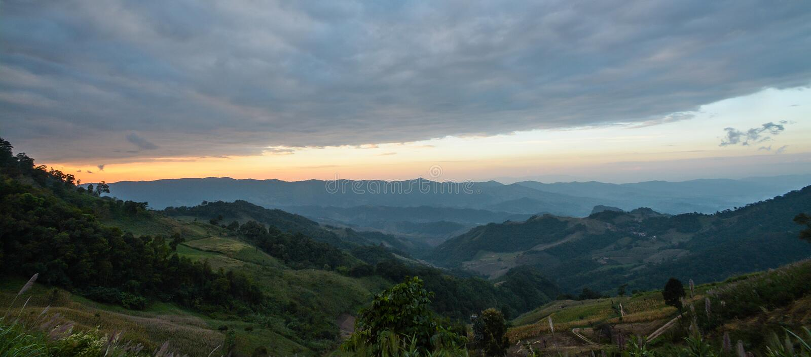 Sunrise scene with the peak of mountain and cloudscape at Phu chi fa ,Thailand stock image