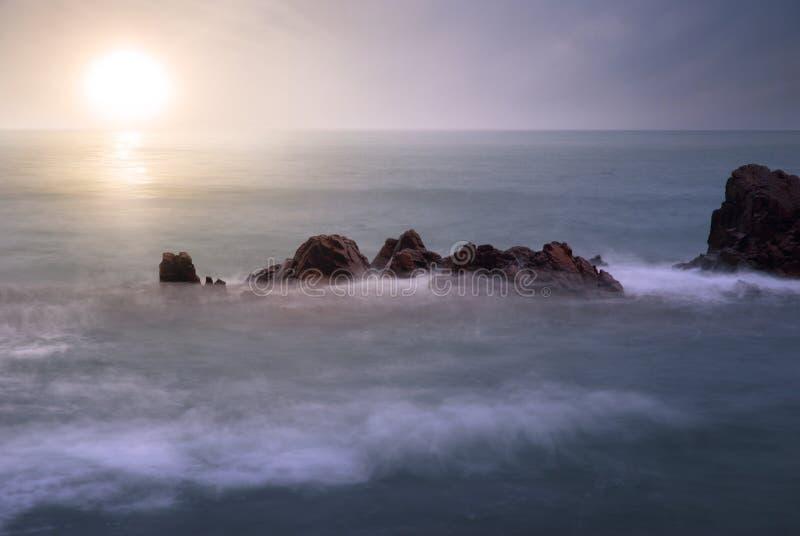 Sunrise at sea. Photo: sunrise at sea and sea looks like cloud royalty free stock images