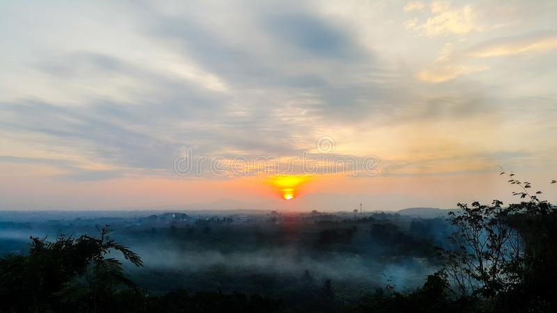 Sunrise with sea of fog from a hill in northern thailand stock images