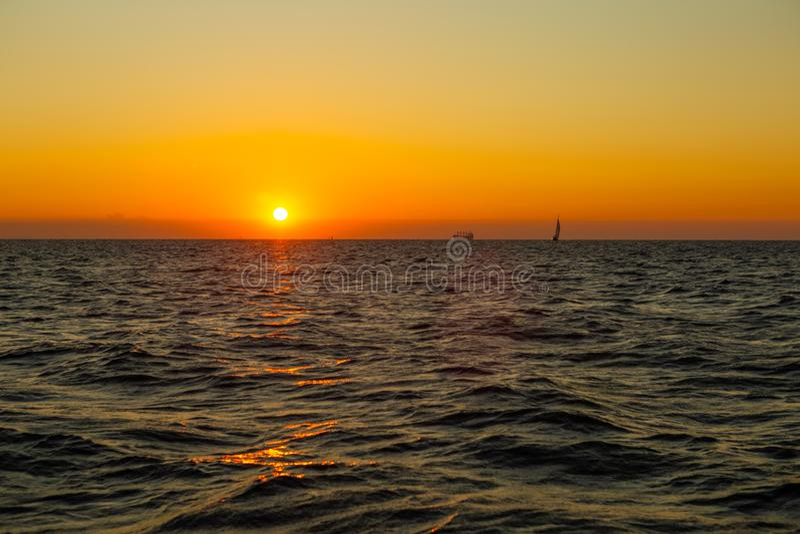 Sunrise sea, morning time, orange colors, calm water.. Sunrise sea, morning time. Concept of calm and romantic. Beautiful landscape, clean sky, sunrise orange stock image