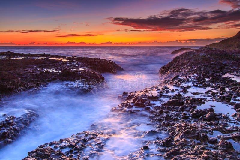 Sunrise on seacoast royalty free stock image