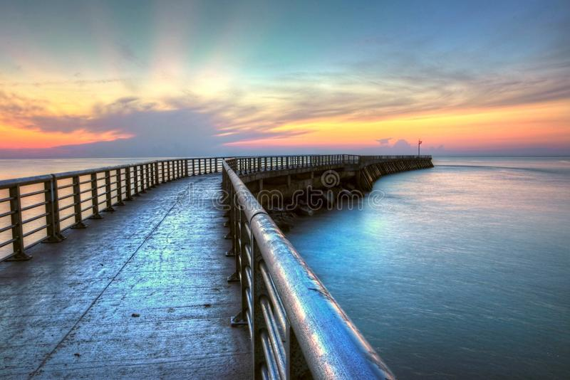 Sunrise At Sebastian Inlet. Amazing sunrise as the sky opens its arms to welcome a new day along the Atlantic coast at Sebastian Inlet stock images