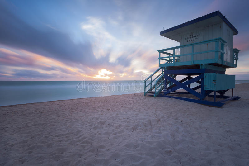 Sunrise seen from a lifeguard post. Sunrise in Miami Beach with a lifeguard post royalty free stock photos