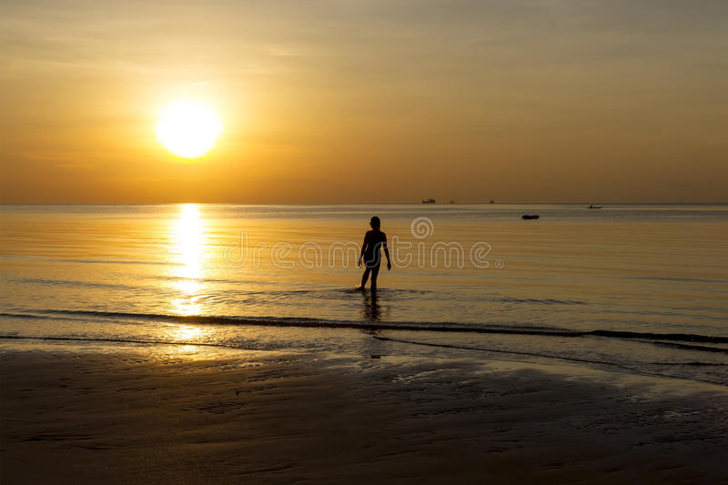 Sunrise show action woman silhouette. On Thung Wua Lan Beach at Chumphon Province, Thailand royalty free stock photos