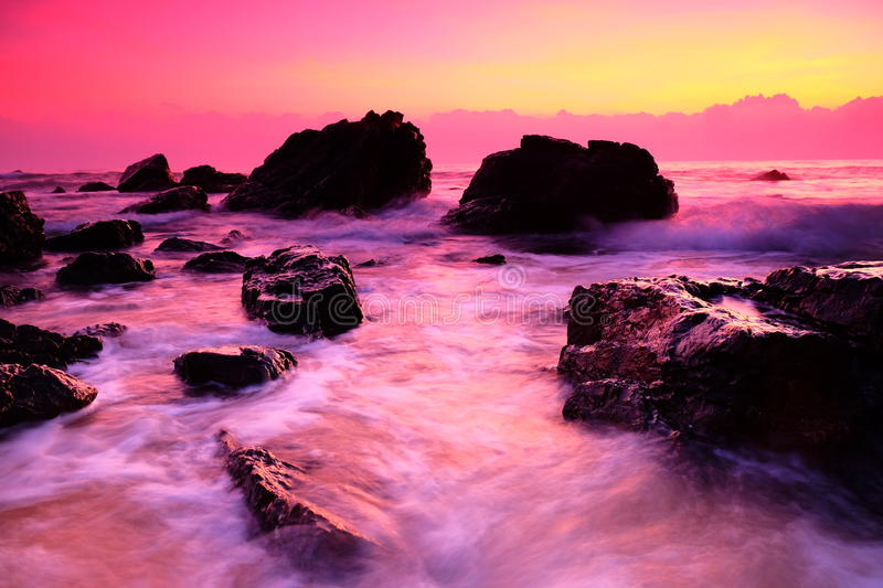 A sunrise at the side of the beach. A beautiful nature to be appreciate with a big rock at Kemasik, Kemaman Terengganu stock photography