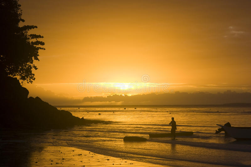 Sunrise silhouette with boatmen stock images