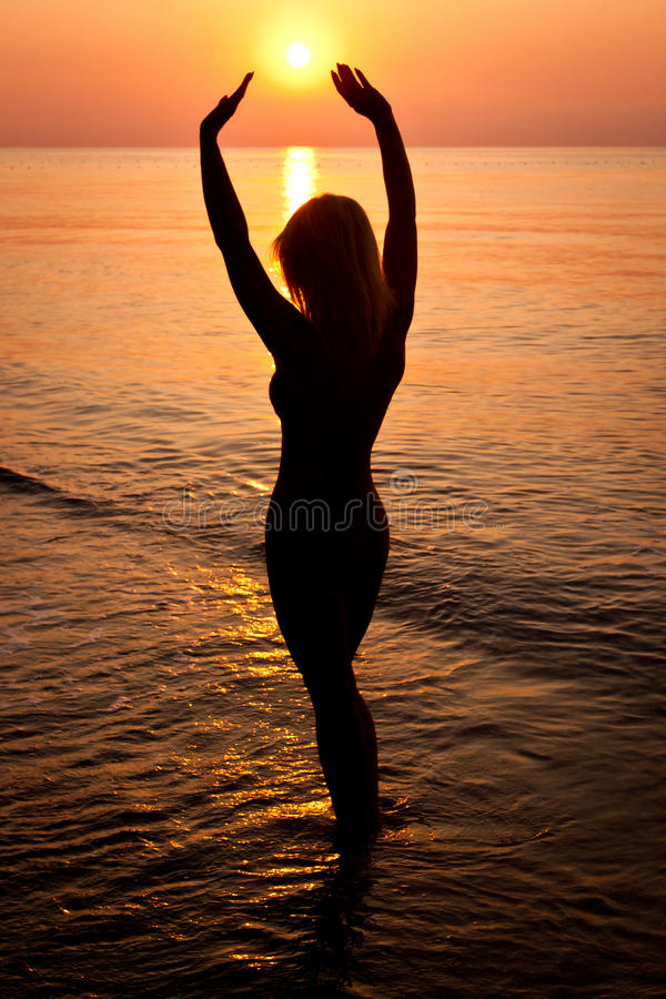 Download Sunrise Silhouette Of A Woman Royalty Free Stock Photography - Image: 19798397