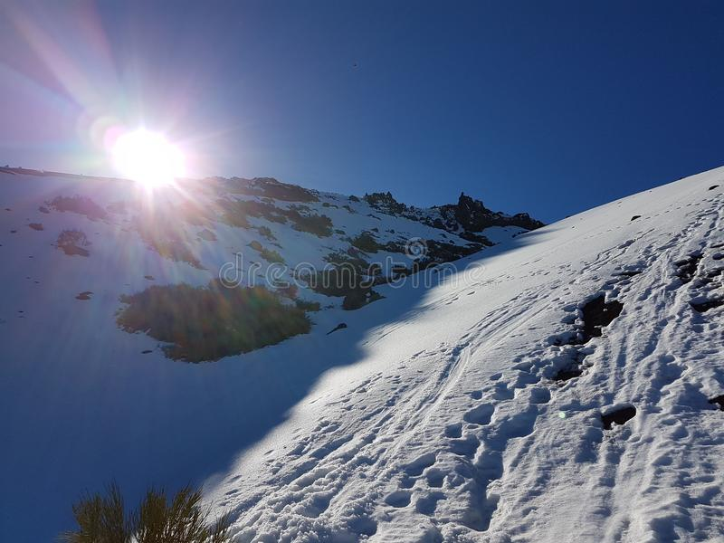 Sunrise with Blue sky, sun and snow in Cañadas del Teide, Tenerife royalty free stock image