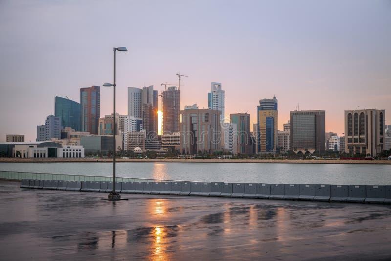 Sunrise in Manama. Sunrise and the skyline of Manama. Manama, Bahrain royalty free stock image