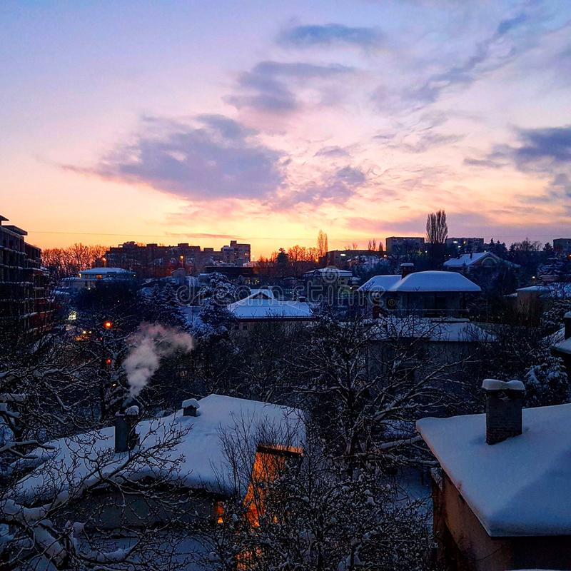 Sunrise in a snowy city royalty free stock photo