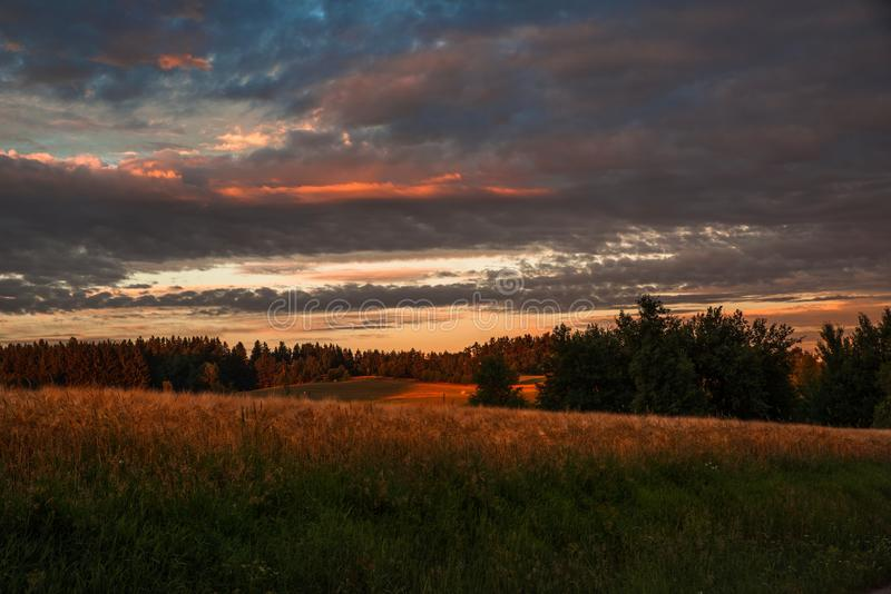 Sunrise in South Bohemia. Sunrise with clouds above countryside with corn field, meadow and forest. Czech republic, South Bohemia royalty free stock photo