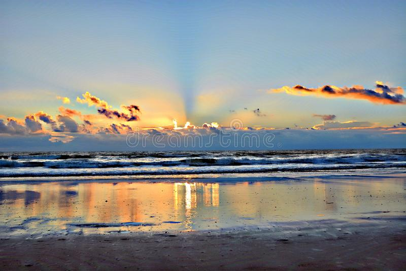 The morning sun rises and shines its light on the surf tidal pools. Sunrise is always spectacular in a colorful manner each and every morning royalty free stock photography