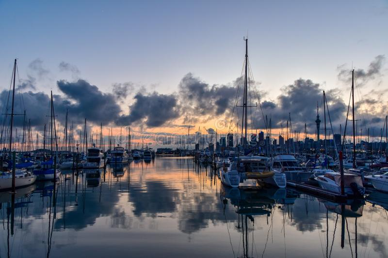 Sunrise at St Mary`s Bay Auckland. View across the bay. Auckland Central visible through the masts royalty free stock photography