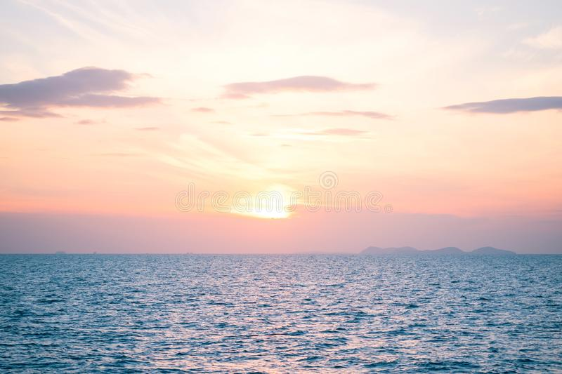 Sunrise and sunset with clouds over horizon blue sea backgr. Beautiful sunrise and sunset with clouds over horizon blue sea background in morning and evening stock image