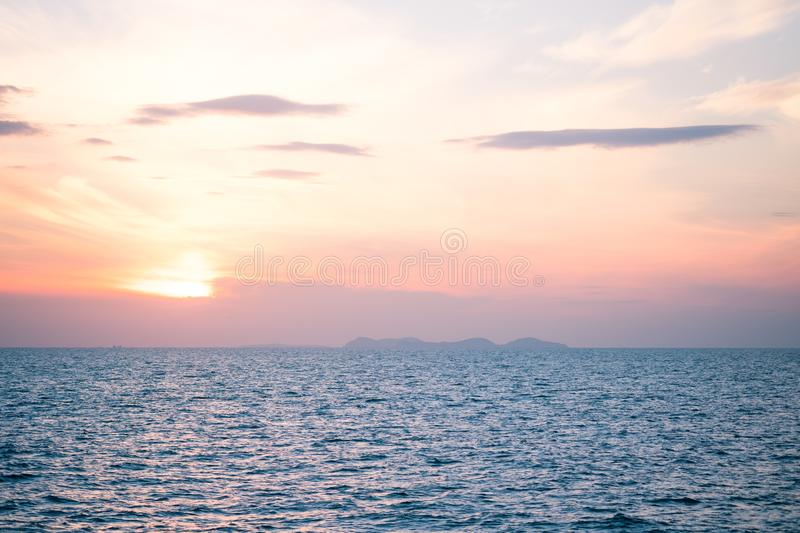 Sunrise and sunset with clouds over horizon blue sea backgr. Beautiful sunrise and sunset with clouds over horizon blue sea background in morning and evening royalty free stock photos